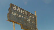Low Angle Old Apartment Building Sign In Small Town- Close Up Stock Footage