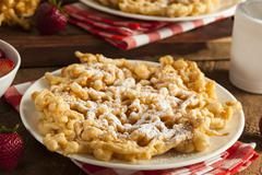 Homemade funnel cake with powdered sugar Stock Photos