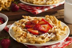 homemade funnel cake with powdered sugar - stock photo