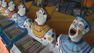 Stock Video Footage of sideshow clowns ball in mouth
