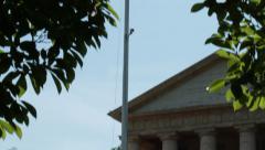 Tilt up on American Flag at half-staff above Arlington House Stock Footage