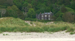 Palace in the forest near by the beach behind coastal dunes Stock Footage