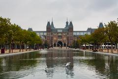 rijksmuseum main facade and pond - stock photo