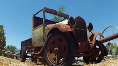 Low Angle Rusted Model T Truck In Small Town Stock Footage