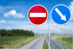 right and wrong direction traffic signs - stock photo
