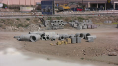 Large sections of pipe on a building site in Cyprus Stock Footage