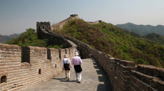 Tourists on a beautiful section of great wall of china beijing mutianyu Stock Footage