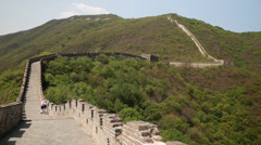 Tourists on the beautiful section of great wall of china beijing mutianyu Stock Footage