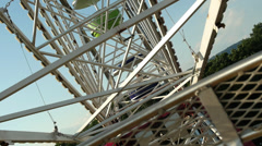 Pov view of Ferris wheel from seat with trees amusement park ride festival - stock footage