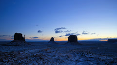 Time lapse Monument Valley dawn Mittens snow  desert Colorado Plateau, Utah, USA Stock Footage