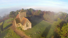 Aerial: Church above the clouds Stock Footage