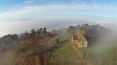 Aerial: Church Above the Clouds 2 Stock Footage