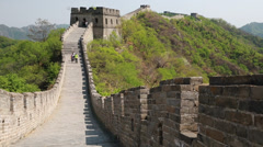 Tourists hiking on the beautiful section of great wall of china beijing mutia Stock Footage