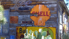 Old Signs On Side Of Weathered Wooden Shed- Hackberry AZ Stock Footage