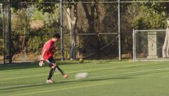 2.5K Soccer Keeper Plays out of back Stock Footage