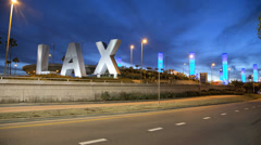 Time lapse LAX sign night traffic International Airport Los Angeles USA Stock Footage