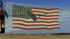 Patriotic Flag And Eagle Painting On Side Of Brick Building - stock footage