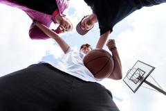 Stock Photo of young people training basketball