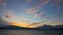 Time lapse sun setting Fjord winter snow skyline Norway Stock Footage
