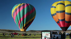 Hot air balloons ready for launch takeoff rural farms HD 3301 Stock Footage