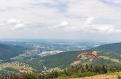 paraglider in little beskids mountains - stock photo
