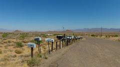 Row Of Mailboxes On Rural Desert Road- Kingman AZ Stock Footage