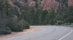 Traffic around mountain corner southwest Utah HD 174 Stock Footage