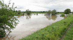 Flooded fields over grounded rampart,pan right to overflowed coast Stock Footage