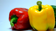Stock Video Footage of Green, Yellow and Red Peppers Against White - Line Arrangement