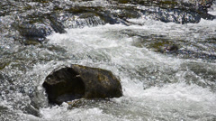 White mountain stream water falling down bursting ecology background hd Stock Footage