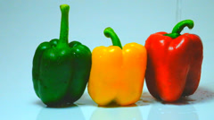 Pour water into sweet peppers Stock Footage