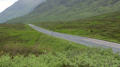 Empty country road in glencoe, scotland Stock Footage