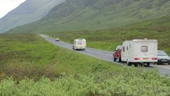 Holiday traffic drives along country road in glencoe, scotland Stock Footage