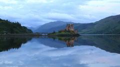eilean donan castle at dusk, dornie, highlands, scotland - stock footage