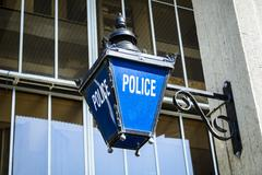 Old fashioned police sign Stock Photos