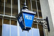 Stock Photo of Old fashioned police sign