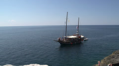 Junk sailboat passing by giola in Thassos Greece - stock footage