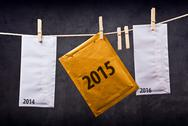Stock Photo of three envelopes with year numbers on clothes rope