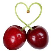 Cherries forming a heart love topic Stock Photos