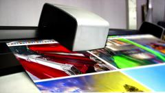 Offset machine press print run at table, fountain key color management spectr Stock Footage