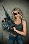 Beautiful blond woman with heavy perforator in her hands Stock Photos