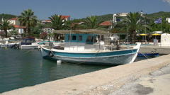 Pan from Fishing boat to the harbor of skala kallirachi, Thassos Greece Stock Footage