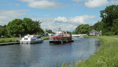 Tour boat passes at tomnahurich bridge, inverness, scotland Stock Footage