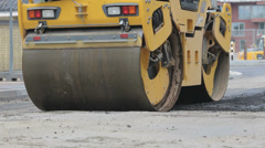 Road roller on new asphalt Stock Footage