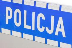 Polish police sign on a door of police car Stock Photos