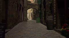 POV. Italy, Tuscany, on ancient streets of Volterra. Steady cam shot. Stock Footage