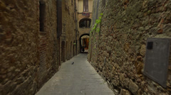 POV. Italy, Tuscany, on ancient streets of Volterra. Steady cam shot. - stock footage