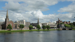 Churches on banks of river ness, inverness, scotland Stock Footage
