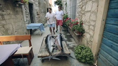 Early in the morning, the owner of the restaurant with an assistant take fishes Stock Footage
