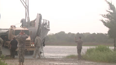 Petrol tanker Vehicle offload of a Landing Craft Utility Stock Footage